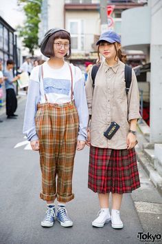 Moe and Arai on the street in Harajuku wearing resale looks features plaid pants and a plaid skirt, a bows backpack from Tokyo Bopper, a Marc Jacobs backpack, and Converse sneakers. Full Look Tokyo Street Fashion, Tokyo Street Style, Japanese Street Fashion, Japan Fashion, Korean Fashion, Fashion 2015, Paris Street, Grunge Outfits, Edgy Outfits