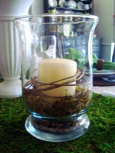 hurricane candle centerpieces wedding ideas for spring   The glasses are my Walmart Libby goblets. Four for $5.00. Cheap!! I've ...