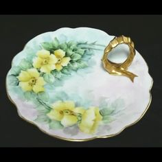 Antique Yellow Rose Hand Painted Porcelain Plate Gilded Handle.  Pretty piece for biscuits or lemon slices or whatever else you serve at your dinner or tea parties.
