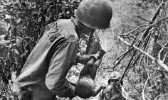 Hell in the Pacific: Rare World War II photographs show American soldiers' fight for survival in brutal Battle of Saipan #DailyMail