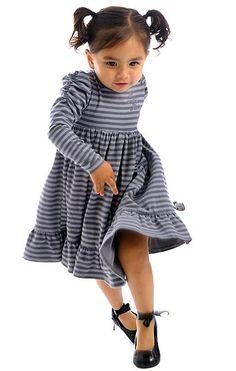 Fall 2012 Designer's Favorite: Servane Barrau's Little Stripped Dress. The jersey stripe long sleeve dress with flocking and shirred sleeves.  www.servanebarraudesigns.com