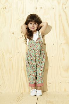 Dungarees for kids are a What Mother Made staple! The highest quality girls handmade clothes in bold prints for a bright summer! They have a beautiful pleated font which gives the pantaloon the wonderful full shape. They have an elasticated back which gives room for growing and two buttons for adjustable length. The perfect clothes for babies and toddlers.