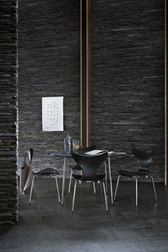 black stone wall Series 7 By Arne Jacobsen produced by   Fritz Hansen