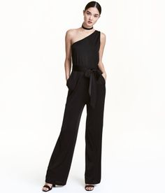 Check this out! Sleeveless, one-shoulder jumpsuit in airy, glossy jersey. Elasticized seam and tie belt at waist, side pockets, and straight legs. - Visit hm.com to see more.