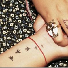I really like these bird tattoos....