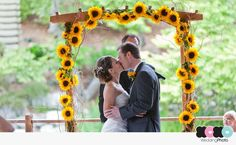 The sunflowers are cute, but I want an idea for something else to add to the archway.. something white other than roses? halloween-wedding