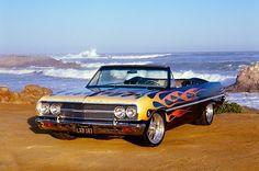 1965 Chevrolet, Chevelle, Malibu Black With Flames Front View On Sand By Ocean 1965 Chevelle, Chevrolet Chevelle, Chevy, Malibu For Sale, Malibu Black, Cool Old Cars, Custom Cars, Custom Trucks, Car Travel