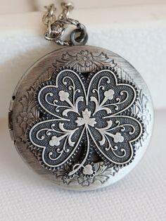 Irish Shamrock Silver Locket,Locket,Four Leaf Clover Locket,Antique Locket,Luck,Irish,Wedding Necklace,bridesmaid necklace. $29.99, via Etsy.