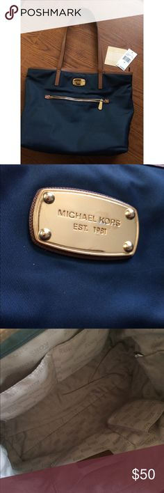 Michael Kors Tote Preloved Michael Kors tote bag! Navy blue in color with gold hardware.  Minor flaws with the straps shown in picture 4, and barely visible scratches on the Michael Kors gold plate, shown in picture 2. There are a few marks barely noticeable on the fabric that can be cleaned! Other than that no permanent stains or other flaws!  Can fit most laptops! - height with shoulder straps is about 24 in  Comes with original tags!  Open to reasonable offers :) Michael Kors Bags Totes