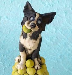 Border Collie Dog on Pile of Tennis Balls Ceramic by RudkinStudio, $120.00 > Ben knew where every tennis ball was, EVERYWHERE! I always suspected he had TB-GPS and a database...