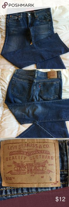 Levi's 518 super low boot cut jeans Have been rodeo jeans and have max fading on knees.  No rips or tears.  Low rise with stretch.  Measures 15 inches across front at top, lying flat.  Leg inseam is 28 inches Levi's Jeans Skinny