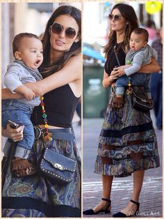 Bonding time: Nicole Trunfio, 29, was seen cradling her seven-month-old son Zion at Sydney's Bondi Beach on Saturday Nicole, 29, looked chic in a flowing multi-coloured skirt which featured strips of sheer material and teamed it with a black crop top, dark belt and blue flats.