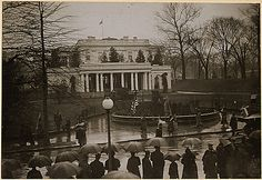 Suffragists picket the White House. Photo shows suffragists, carrying banner, on picket duty at the east entrance of the White House, Washington, District of Columbia. National Archives, Record Group 165, ARC 533771
