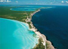 The Atlantic Ocean and The Caribbean Sea separated at the Glass Window Bridge, Eleuthera