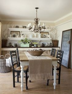 Cottage Country White Decor Inspiration - Just hang chuncky long crown molding shelves on one wall  -then a long country style table underneath and you have just created an amazing buffet area below with dish storage and decor shelves above. Love this idea love this room!