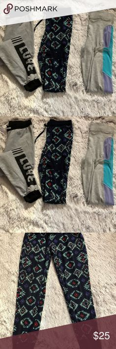 Joggers bundle 3 joggers bundle  The grey and black are a size large  The light grey danskin are extra large  The blue are size large Pants Track Pants & Joggers