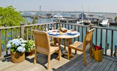 Stay in a charming Nantucket cottage with views of the water basin and the perfect place to dine al fresco.