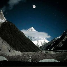 Moon over K 2 , 2nd highest mountain in the world With a peak elevation of 8,611 m (28,251 feet), K2 is part of the Karakoram Range, and is located in the Gilgit–Baltistan region of Pakistan