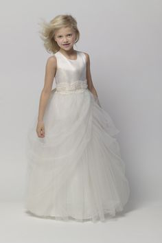 Diamond white crystal satin sleeveless bodice with an ivory tulle shirred, multi layered ball gown floor length skirt.