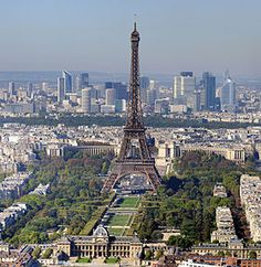 Paris, with the skyscrapers of La Défense in the background and the Eiffel Tower in the foreground