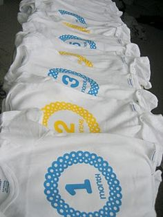 Great baby shower gift ... onesies for 1 month to 1 year ... adorable!  Made with custom iron-ons and a silhouette machine.
