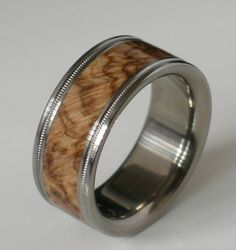 Titanium Wood Ring Brown Maple Burl Band Custom Wedding Band Available in Comfort Fit Mens and Ladies Size 4-18 Unique Exotic Wooden Design. $185.00, via Etsy.