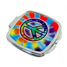 "Compact Makeup Mirror with Peace Symbol Design. This handy mirror compact is approx. 2 1/2"" X 2 1/2"". It is of metal construction and has a metal clasp and hinge. Two mirrors, one is regular, one magnifies."