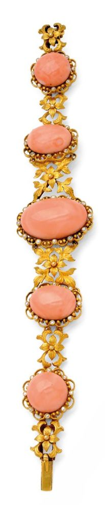 A Coral, Diamond and Gold Bracelet, circa 1895.  Set with a series of five graduated corals within conforming filigree frames with tiny old mine-cut diamonds, between connecting links of floral and acanthus leaf medallions, mounted in 18k gold, signed JEC & Co. for J.E. Caldwell & Co. and numbered D9637