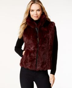 An easy-glide zipper plus hand pockets make this plush rabbit fur vest a favorite for keeping warm and looking chic. From Surell. | Rabbit fur; Lining: Polyester | Dry clean | Imported | Front zip clo