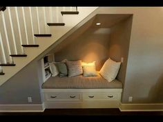 Under stairs- great use of the space.