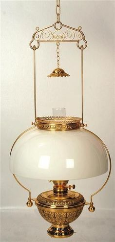 To introduce some old-time vibe into the interior, you just need a few pieces of decoration. An antique hanging oil lamp definitely does the job and infuses the space with character. Antique Oil Lamps, Antique Chandelier, Antique Lighting, Vintage Lamps, Victorian Lighting, Chandeliers, Hurricane Oil Lamps, Lantern Lamp, Lanterns