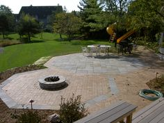 Brick and bluestone patio with fire pit.