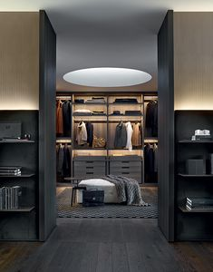 Senzafine walk-in closet in cenere oak melamine. Gant pouf in 01 latte Nabuk leather. Tribeca coffee table piombo painted and glossy Emperador Dark marble top