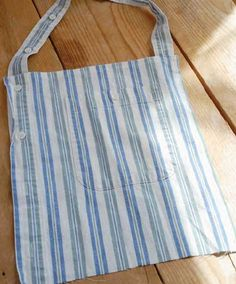 """A little creative cutting and stitching allows you to """"borrow"""" seams and buttonholes from a pair of recycled men's shirts to make a fetching and functional apron that gets down to business in the kitchen."""
