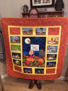 """09/15...Charlie Brown's """"It's the Great Pumpkin"""". Panel included centerpiece and the 12 small rectangles. Corner pieces as well as wide border from same line of fabric. 44"""" wide, 47"""" long"""