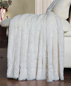 Love this Ivory Double-Sided Faux Fur Throw on #zulily! #zulilyfinds