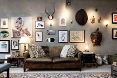 Make your home look amazing with concrete! An industrial hipster boho living room with concrete feature wall