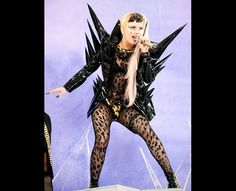 Lady Gaga performed for ABC's 'Good Morning America' at Rumsey Playfield, Central Park on May 27, 2011 in New York City in a black vinyl-spiked custom made Giorgio Armani Prive suit
