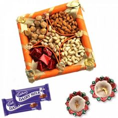 Treat your loved ones to a rich assortment of uniquely blended.Assorted Tray Of Mix Dryfruit Hampers Combo and Decorative Diyas is a Sweet Gift for everyone in this hamper. This is a item thus slight variation may occur in terms of color and design.  Fancy tray of Mix Dry Fruit - 75 gms Diwali Diyas - 2 pairs Dairy Milk Chocolates - 2 pcs https://www.zorataa.com/diwali-offer/assorted-tray-of-mix-dryfruit-hampers