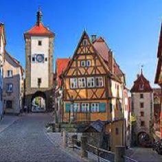 Rothenburg, Germany  I remember walking the wall around this midieval town at daybreak. A print of this famous street sits in my family room.