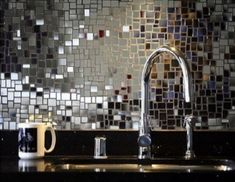 mirrored title backsplash.  Oh my word I love it. I could probably DIY this!