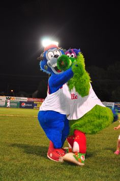 Dancing partners. BOOMER!, the mascot for the Williamsport (A) Crosscutters, shares a dance floor with the Phillie Phanatic