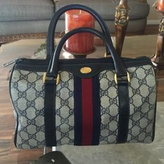 GUCCI BOSTON HANDBAG MADE IN ITALY VINTAGE GUCCI BOSTON MADE OF GG MONOGRAM CANVAS AND NAVY LEATHER AND GOLD TONE HARDWARE. ONE COMPARTMENT WITH INTERIOR ZIP POCKET. IF HAS VISIBLE WEAR ON LEATHER AND LINING. IT STILL IS A BEUTY REGARDLESS OF ITS AGE. Gucci Bags Satchels