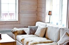 Sofa with light colors + lamb skins
