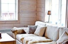 Sofa with light colors + lamb skins