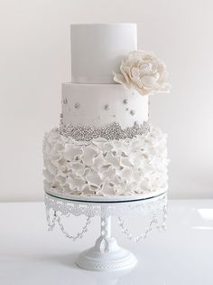 white wedding cake with silver detail