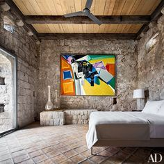 Overlooking the master suite's Lucien Rees Roberts–designed bed is a 1965 painting by Peter Rees Roberts | archdigest.com