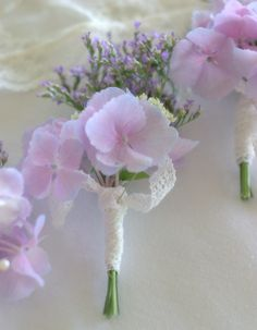 Delicate hydrangea buttonhole informally tied with cotton lace.