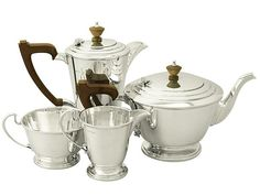 A fine and impressive vintage George VI English sterling silver four piece tea and coffee service in the Art Deco style. SKU: W8948 Price: GBP £1,495.00 #impressive #GeorgeVI #English #silver #tea #coffee #service