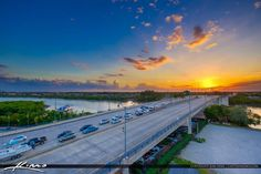 Sunset from Jupiter Florida over the Indiantown Road Bridge in Northern Palm Beach County. Photo taken from the parking garage at Harbourside Place. Florida City, Florida Travel, Jupiter Florida, Palm Beach County, Winter Months, State Parks, Bridge, National Parks, Beautiful Places